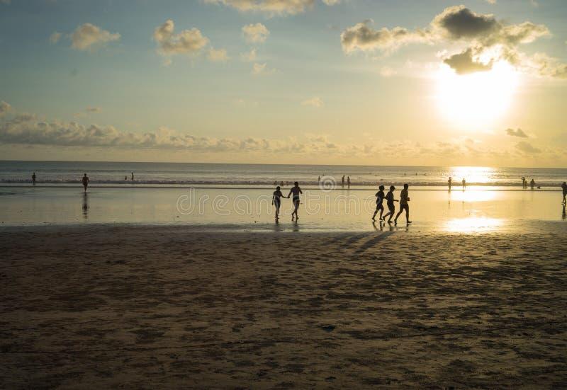 Sport activities at Kuta Beach, Bali-Indonesia in the sunset time stock photos