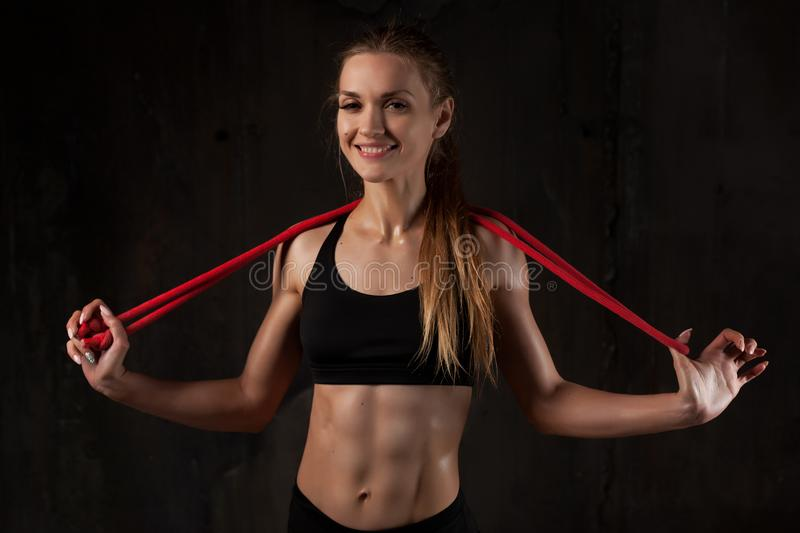 Sport, activity. Cute woman with skipping rope. Muscular girl bl stock photography