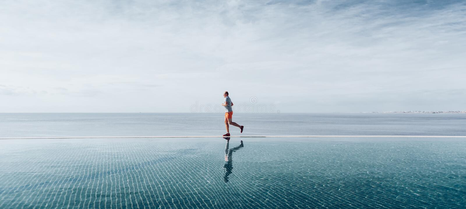 Sport in adulthood. a man over forty years old doing morning jogging stock images