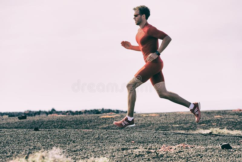 Sport athlete training run on outdoor workout doing cardio workout on running trail outside - Triathlon runner man on run race. Marathon in summer. Fitness and stock photos