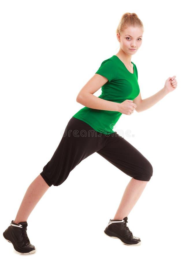 sport Böjlig konditionflicka som gör sträcka övning royaltyfri fotografi