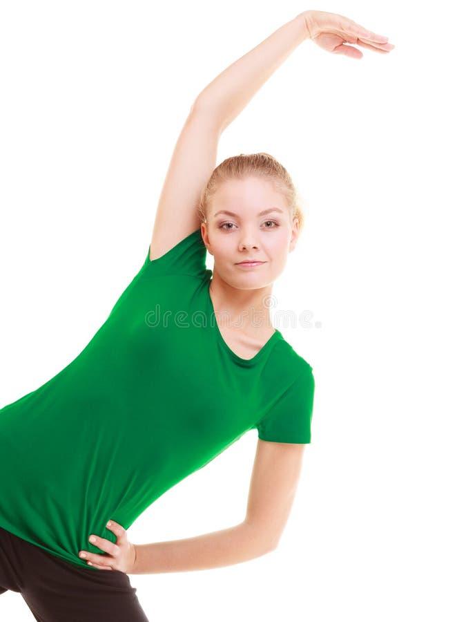 sport Böjlig konditionflicka som gör sträcka övning fotografering för bildbyråer