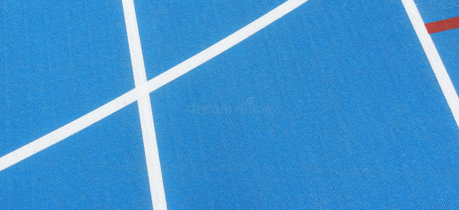 Sport background. Blue running track with white lines in sport stadium. Top view. Sport background. Blue running track with white lines in sport stadium stock photos