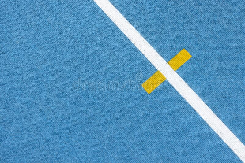 Sport background. Blue running track with white lines and yellow mark in sport stadium. Top view. Blue running track with white lines and yellow mark in sport royalty free stock photography
