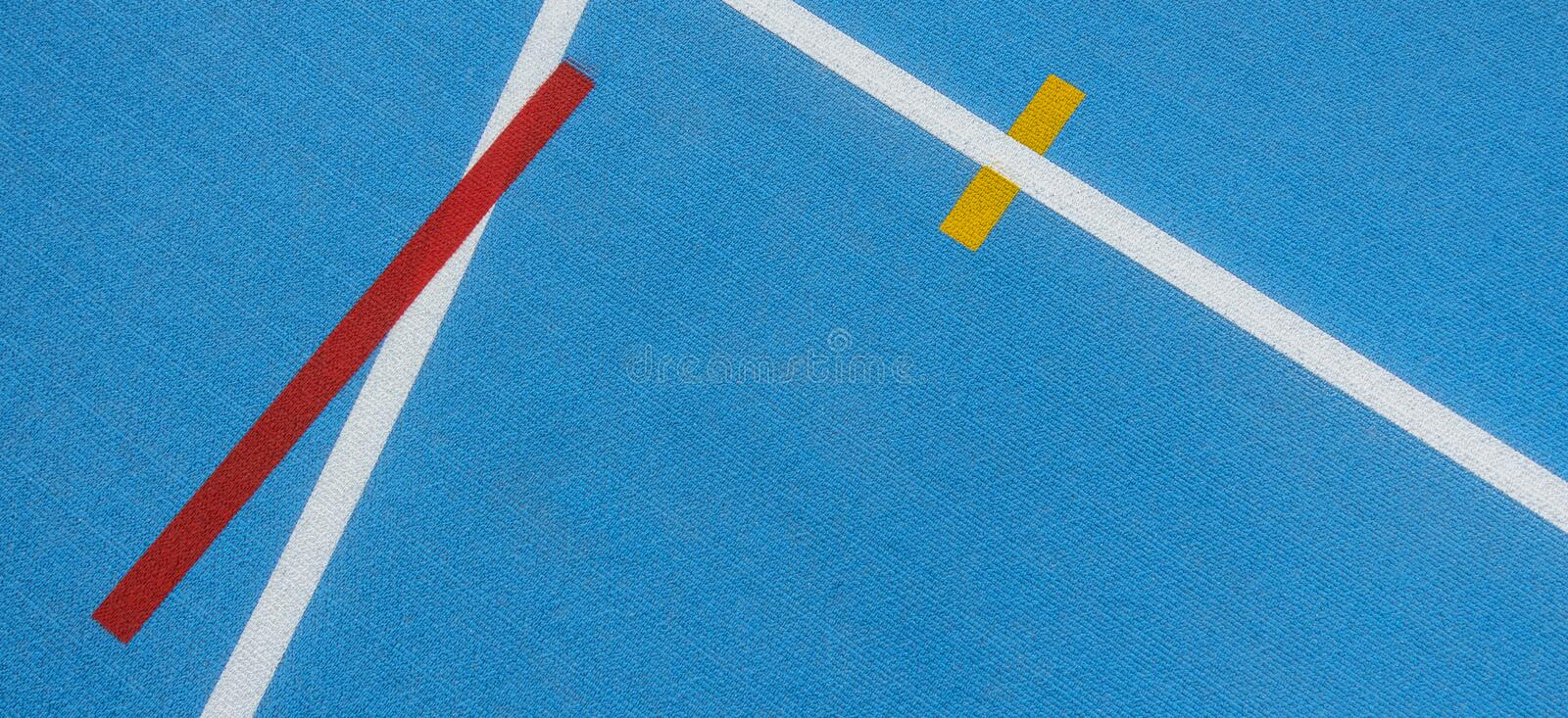 Sport background. Blue running track with white lines, yellow and red mark in sport stadium. Top view. Sport background. Blue running track with white lines stock photo