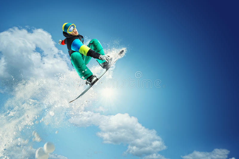 Sport background. Snowboarder jumping. stock photo