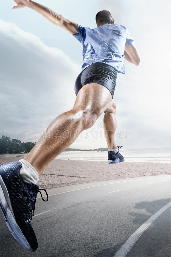 Sport backgrounds. Sprinter starting on the running track. royalty free stock photography