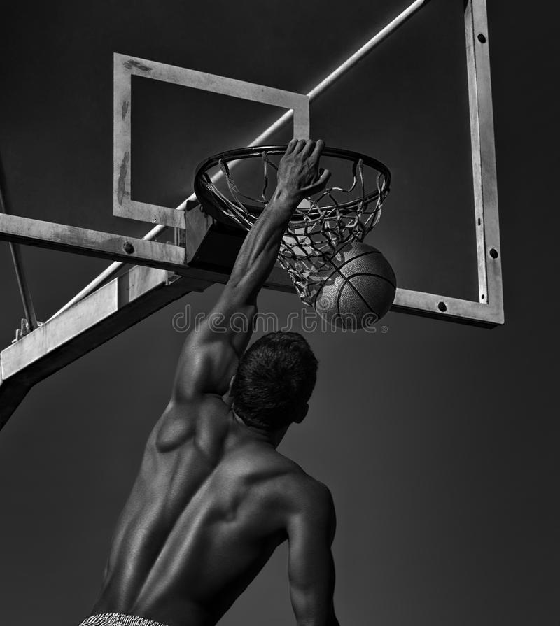 Sport. Basketball player in action -- black and white toned photo stock image
