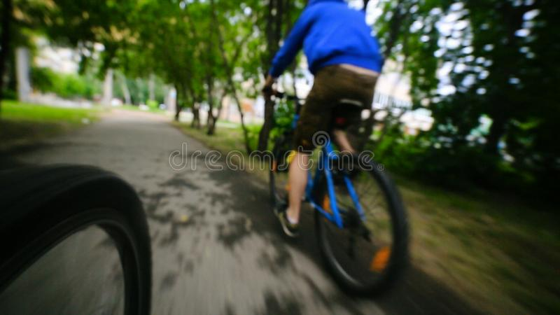 Sport bike - Bicycle wheels and road perspective riding summer. Closeup riding a Bicycle wheel stock images