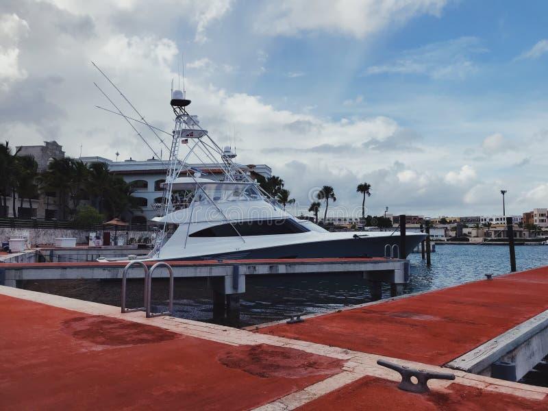 Sport boat for fishing marlin mored in cap Cana marina. Luxury sport boat for fishing marlin mored in cap Cana marina in Atlantic Ocean in Dominican republic stock image