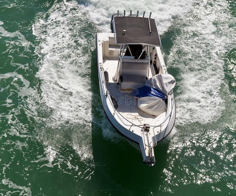 Sport Boat on the Florida Intra-Coastal Waterway. Overhead view of a sport fishing boat speeding on the Florida Intra-Coastal Waterway off Mi Beach royalty free stock photo