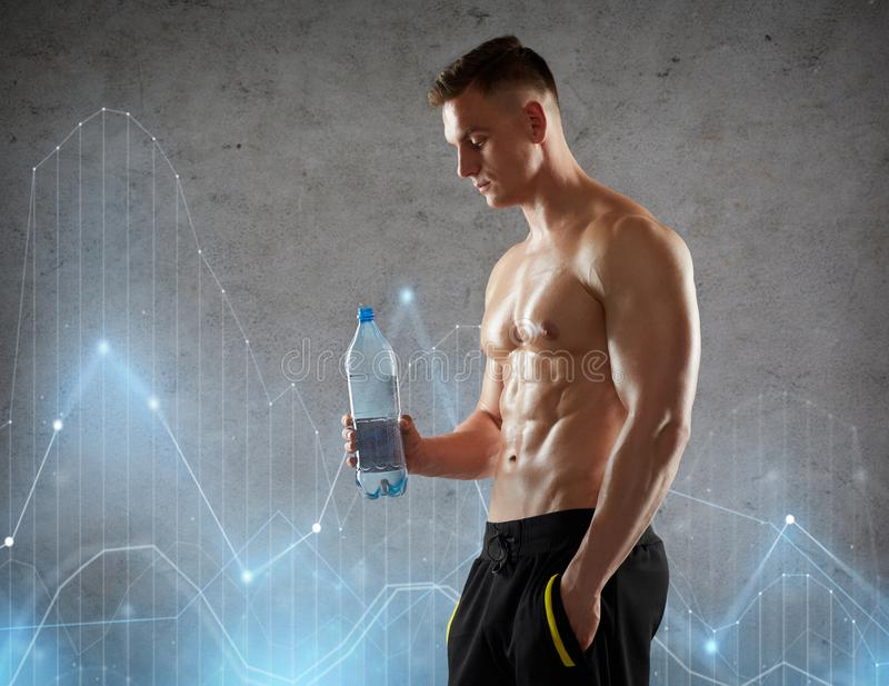 Young man or bodybuilder with bottle of water stock image