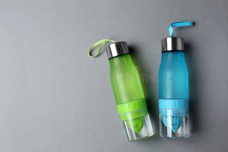 Sport bottles with space for text on color background royalty free stock photos
