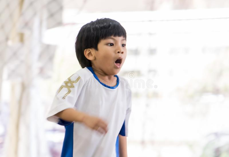 Sport boy with asthma coughing and breathing hard royalty free stock image