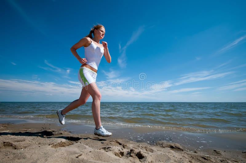 sport brzegowa działająca denna kobieta fotografia stock