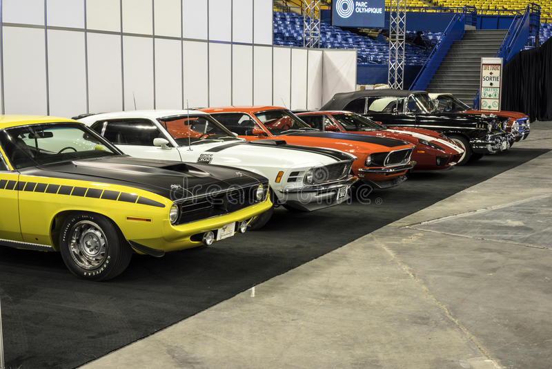 Sport car row. Montreal october 10-12, 2014 picture of a row of muscle cars including, plymouth cuda, mustang boss 302 and others classic cars in display during stock photos