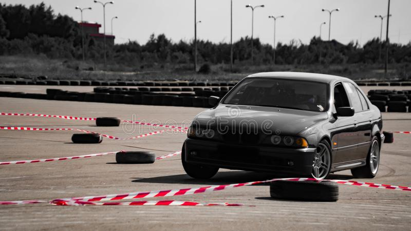 Sport car wheel drifting. Blurred of image diffusion race drift car with lots of smoke from burning tires on speed track. Sport co royalty free stock images