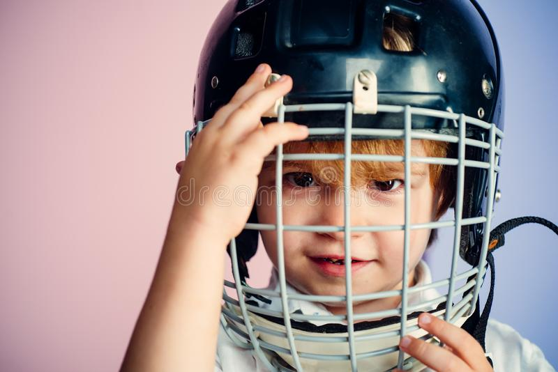Sport childhood. Future sport star. Sport upbringing and career. Boy cute child wear hockey helmet close up. Safety and stock photo