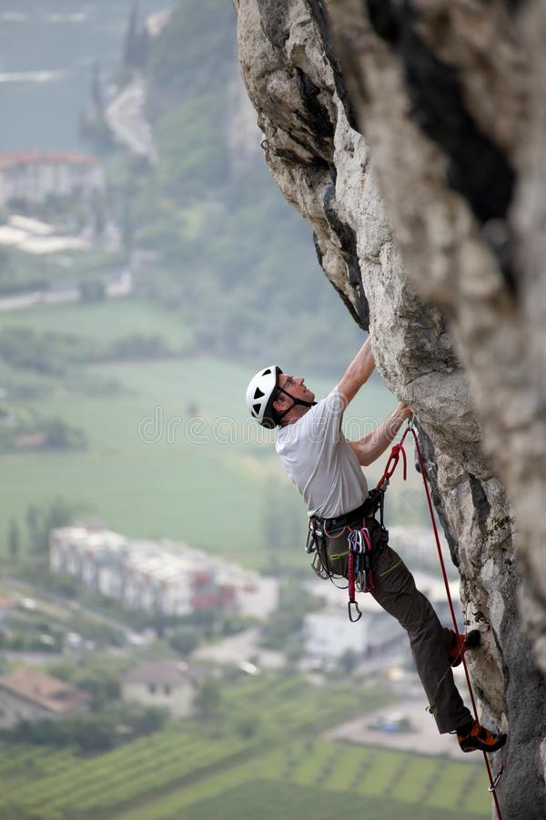 Sport climbing man on a rock wall royalty free stock images