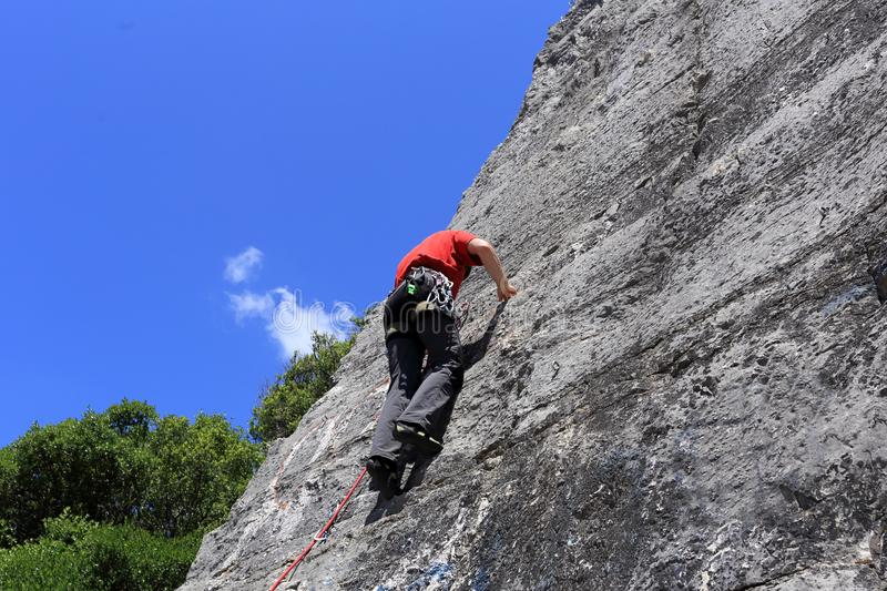 Sport climbing man on a rock wall. In nature stock photo
