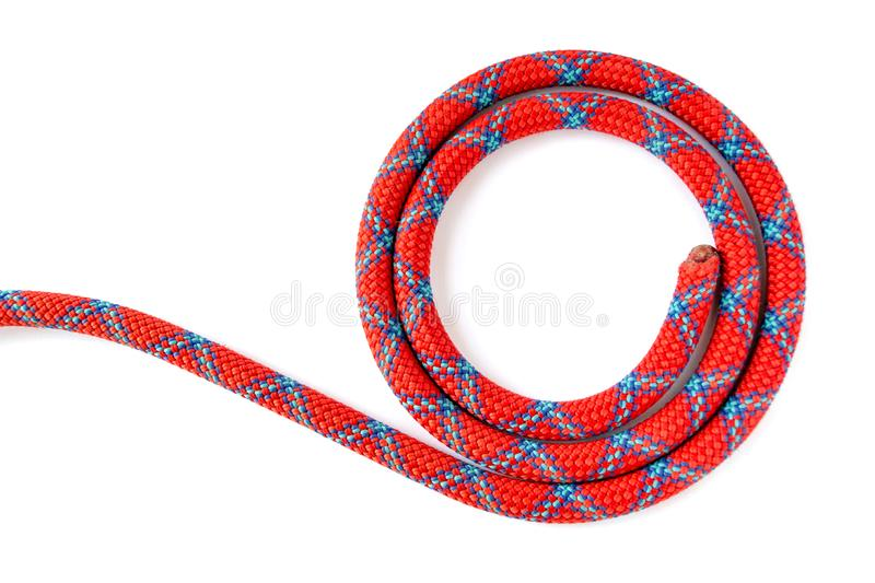 Sport climbing rope, coiled in a circle, isolated on a white background. 10mm mountaineering dynamic rope showing one end only. Sport climbing rope, coiled in a royalty free stock photos