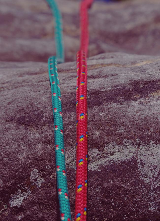 Sport climbing rope. Used colorful nylon ropes without load. Sport climbing rope on rock. Used colorful nylon ropes without load stock photos