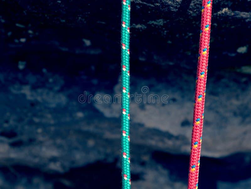 Sport climbing rope. Used colorful nylon ropes without load. Sport climbing rope on rock. Used colorful nylon ropes without load royalty free stock image
