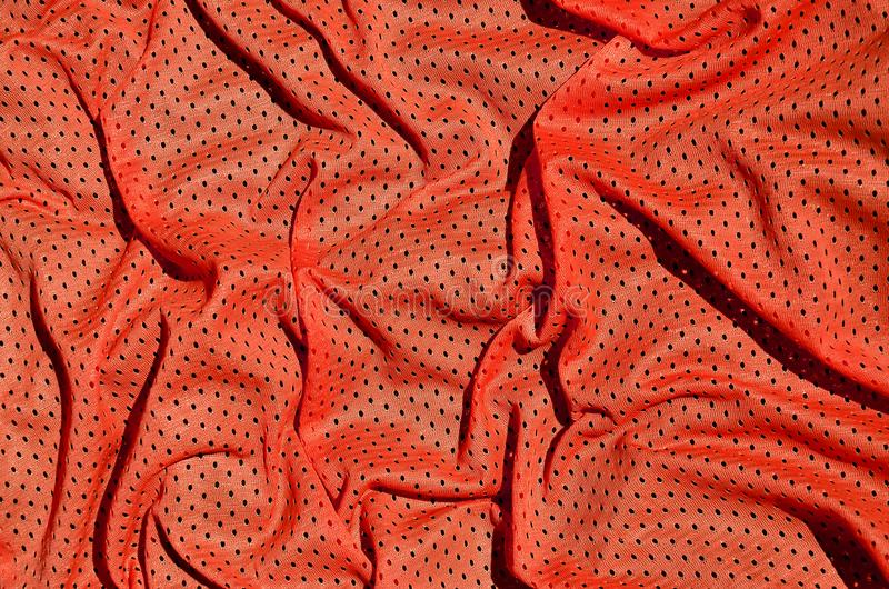 Sport clothing fabric texture background. Top view of red polyester nylon cloth textile surface. Colored basketball shirt with fr royalty free stock photo