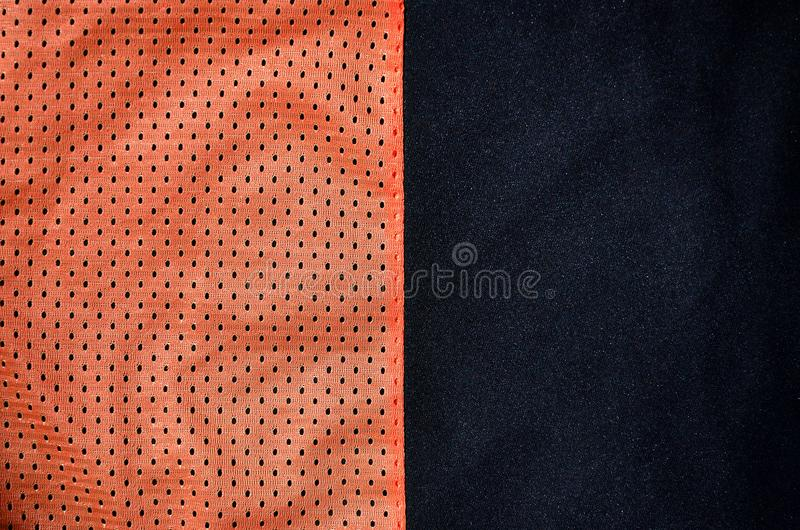 Sport clothing fabric texture background. Top view of red polyester nylon cloth textile surface. Colored basketball shirt with fr. Ee space for text stock photo