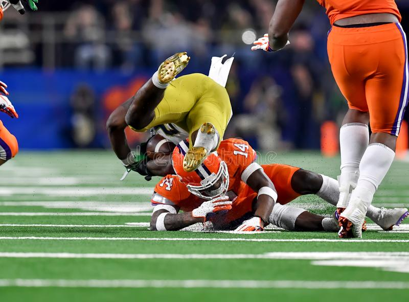 American Football Game with amazing tackling. Great action photos of football players making amazing plays during a football game royalty free stock image