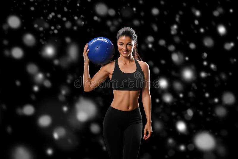 Sport Concept van de het lichaams het sterke en mooie Winter van de vrouwensport met royalty-vrije stock fotografie