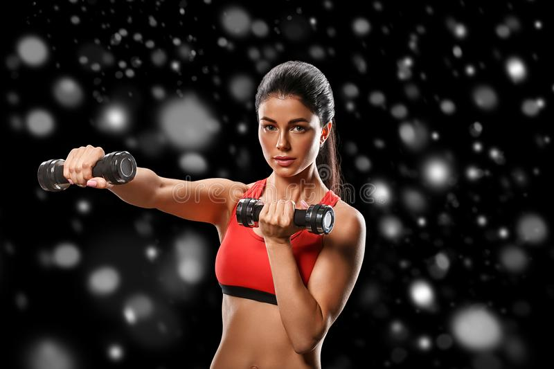 Sport Concept van de het lichaams het sterke en mooie Winter van de vrouwensport met stock fotografie