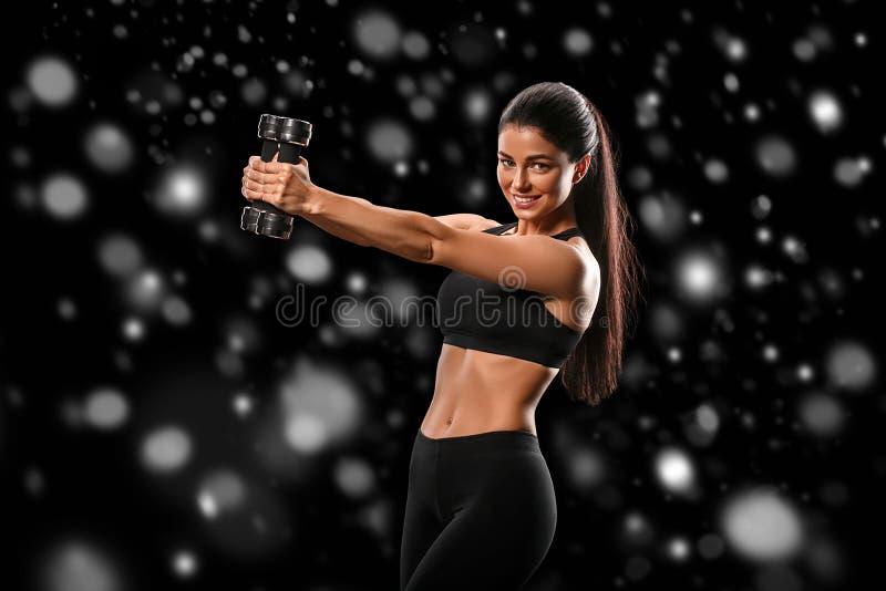 Sport Concept van de het lichaams het sterke en mooie Winter van de vrouwensport met stock foto's