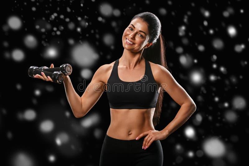 Sport Concept van de het lichaams het sterke en mooie Winter van de vrouwensport met royalty-vrije stock foto