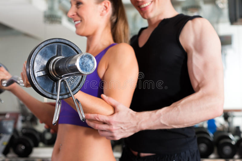 Sport - Couple Is Exercising With Barbell In Gym Royalty Free Stock Photos
