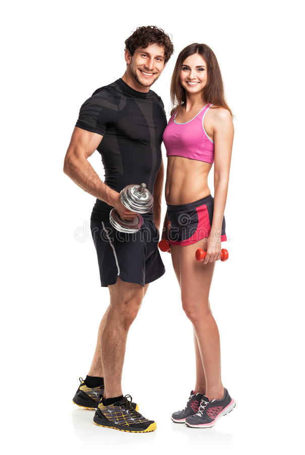 Sport couple - man and woman with dumbbells on the white stock photos