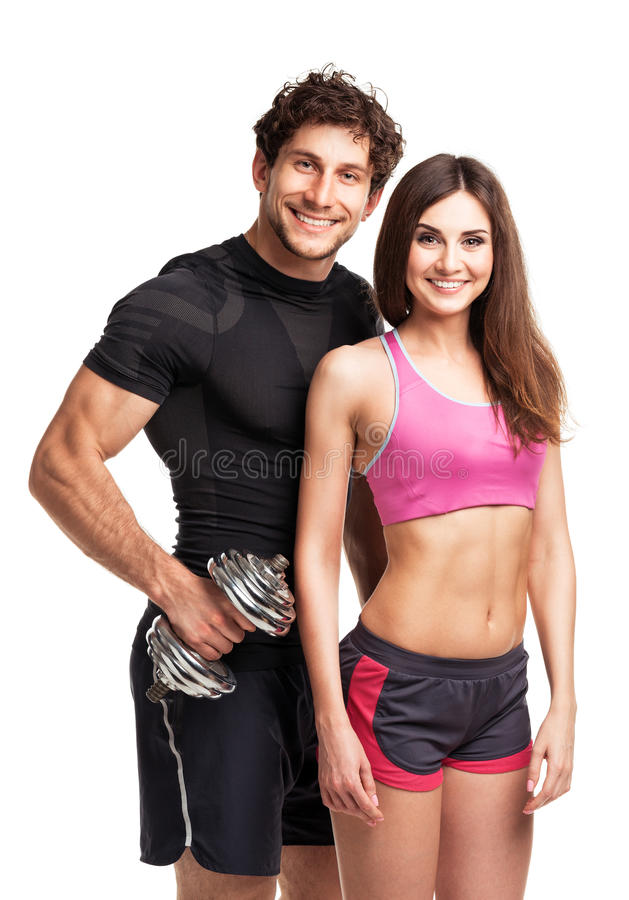 Sport couple - man and woman with dumbbells on the white royalty free stock image