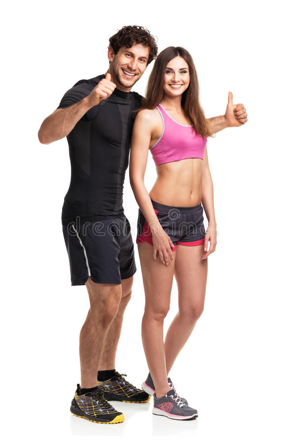Sport couple - man and woman after fitness exercise on the white stock photo