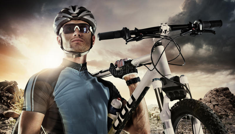 Sport. Cyclist. Carry a bike on dramatic sky stock photography