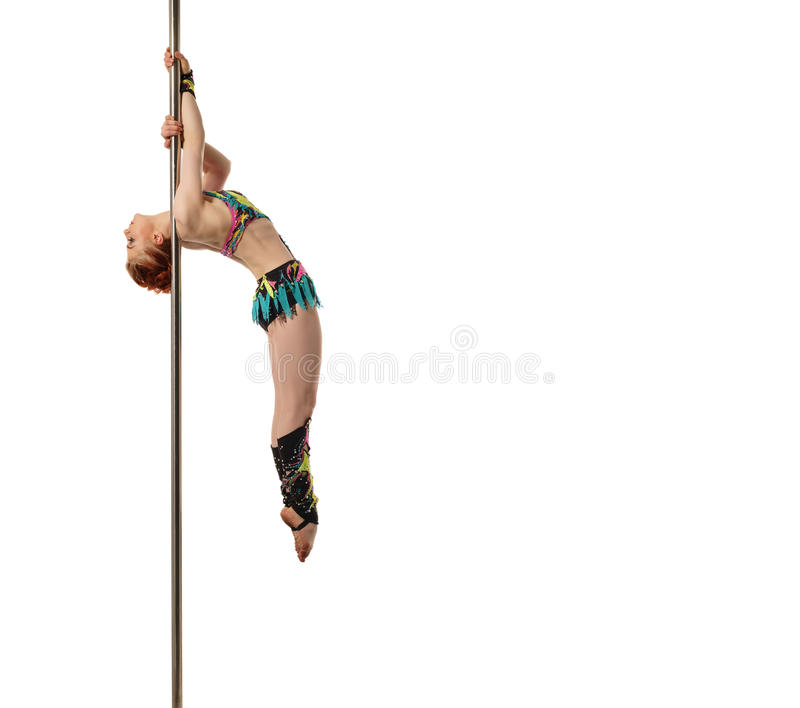Sport and dance. Red-haired gymnast posing on pole royalty free stock photography