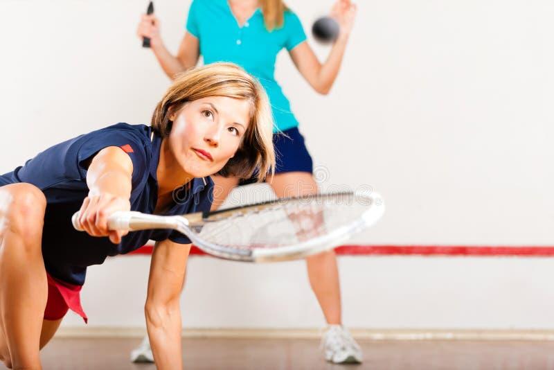 Sport de raquette de courge en gymnastique image stock