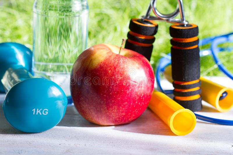Sport diet and active healthy lifestyle springtime concept with outdoor exercise equipment royalty free stock photography