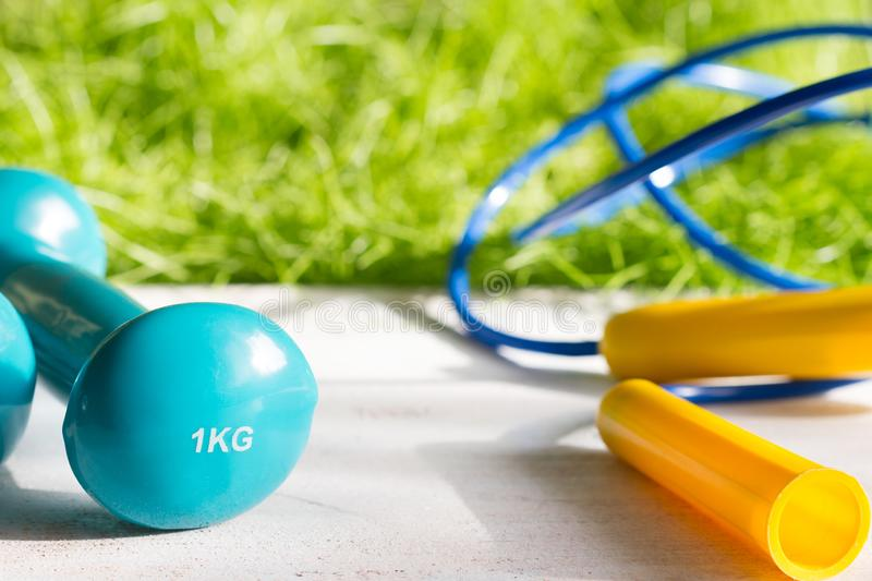 Sport diet and active healthy lifestyle springtime concept with outdoor exercise equipment. Closeup royalty free stock photo