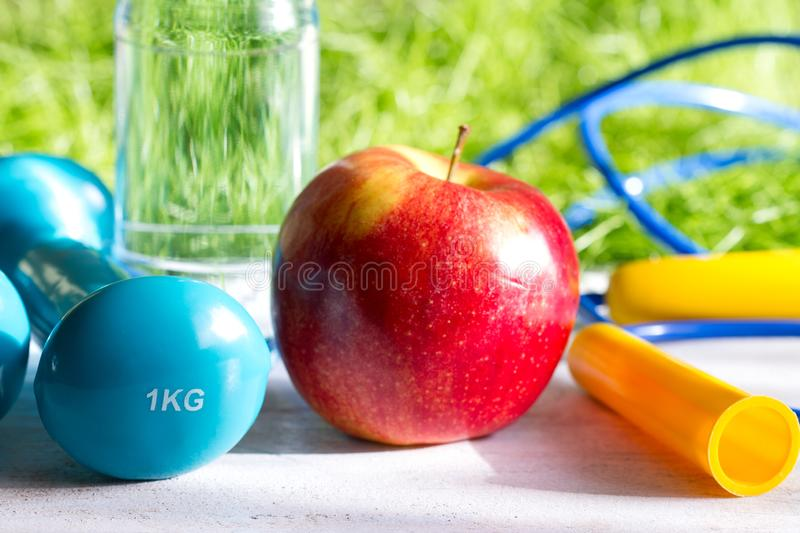 Sport diet and active healthy lifestyle springtime concept with outdoor exercise equipment. Closeup stock image