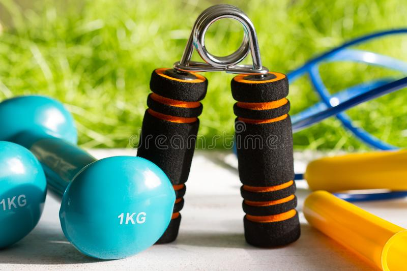 Sport diet and active healthy lifestyle springtime concept with outdoor exercise equipment. Closeup stock photo
