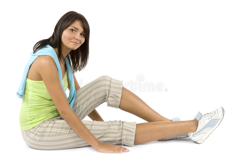 Sport dressed woman does exercise. Isolated sport dressed woman does exercise royalty free stock image