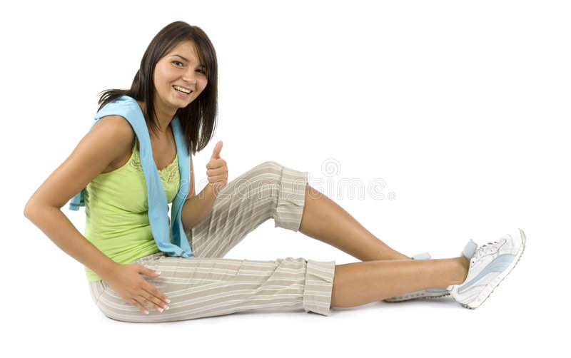 Sport dressed woman does exercise. Isolated sport dressed woman does exercise royalty free stock photography