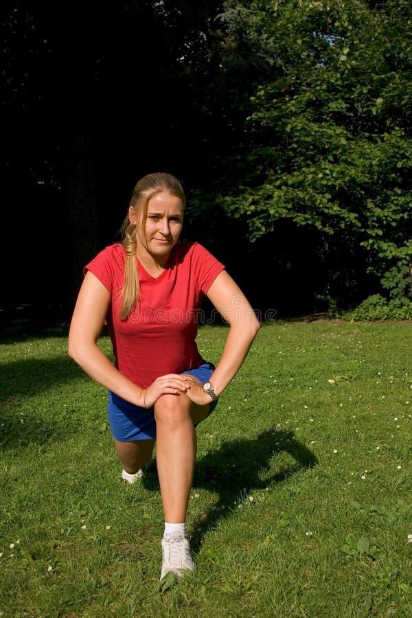 Sport en vrouw stock afbeelding