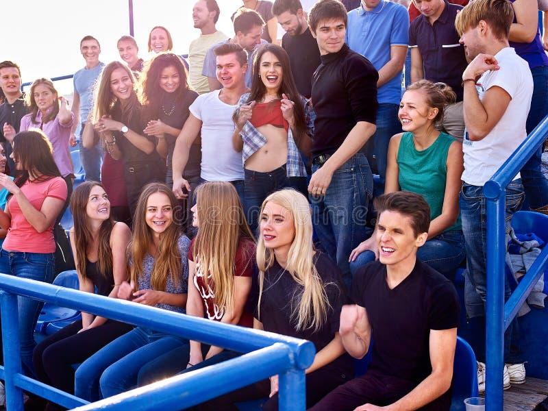 Sport fans beautiful girl asnd men on tribunes. Sport fans beautiful girl and men on tribunes. Group people stock image