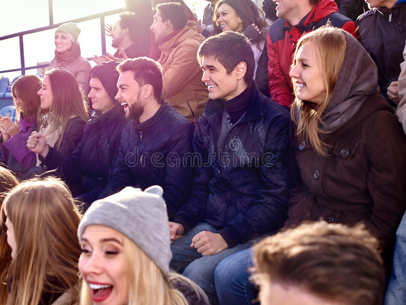 Sport fans clapping and singing on tribunes. Sport fans clapping and crying on tribunes. Group people stock photos